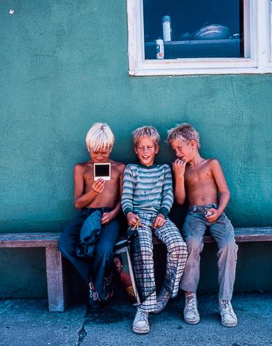 Three Boys and a Polaroid © Jann Alexander